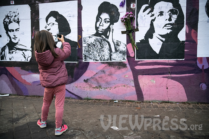 MADRID, SPAIN – MARCH 08: A girl takes a photograph  in front of the feminist mural that has been sabotaged the night before 8M in the Ciudad Lineal neighborhood on 8 march in Madrid, Spain. Various demonstrations and protests have been carried out to celebrate and commemorate the international day of working women that is celebrated every year on March 8. (Photo by Joan Amengual / VIEWpress via Getty Images)