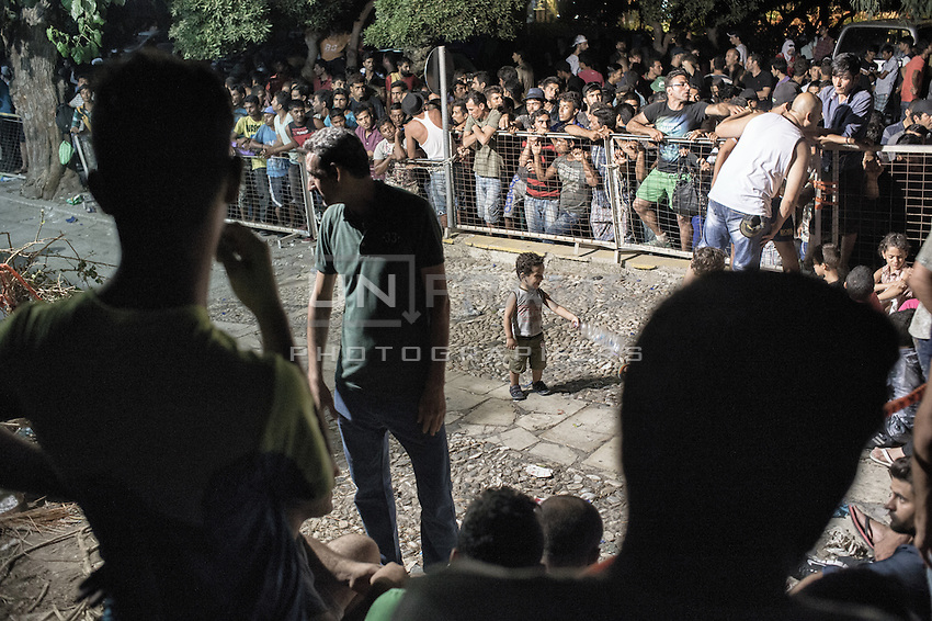 Chaos at the police station where only 6 officers are dealing with the registration of all the refugees. Every night they gather outside, waiting for their turn. Once registered, they are issued with permits for their passage to Athens from where most of them seek to reach Germany or other Western European countries. Kos, Greece. Sept. 5, 2015