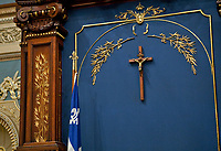 A crucifix is seen above the Speaker's chair at the national Assembly (Assemblee Nationale) in Quebec city Wednesday March 9, 2011.<br /> <br /> PHOTO :  Francis Vachon - Agence Quebec Presse