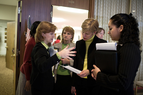 March 17, 2009. Raleigh, NC.. Images from one day in the life of Deborah K. Ross, Representative for North Carolina House District 38.. 10:55 AM. Ross stops in the hallway of the legislature to talk to staff and colleagues on her way to a meeting of the education committee..Her intern, Jezzette Rivera, right, follows along.