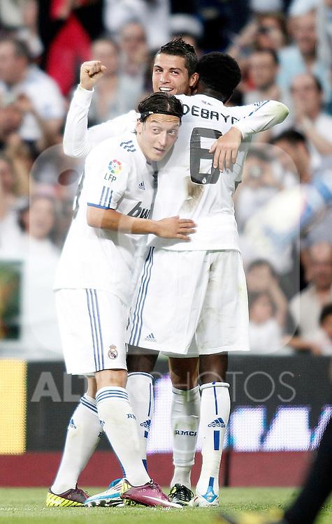 Real Madrid's Cristiano Ronaldo celebrates with Emmanuel Adebayor and Mesut Özil during La Liga Match. May 21, 2011. (ALTERPHOTOS/Alvaro Hernandez)