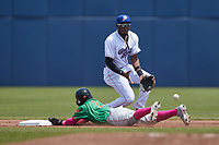 Bryan Ramos (10) of the Kannapolis Cannon Ballers fields a throw as Luisangel Acuna (2) of the Down East Wood Ducks slides head first into second base at Atrium Health Ballpark on May 9, 2021 in Kannapolis, North Carolina. (Brian Westerholt/Four Seam Images)