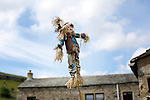Scarecrow Festival at Kettlewell in Yorkshire 2013<br /> <br /> Small one on a stick<br /> <br /> <br /> Scarecrows are made by local community and places in and around their front gardens.  Competition is fierce but it's all to raise money  for the local church  and other local projects to benefit the whole community.<br /> <br /> <br /> <br /> Picture by Gavin Rodgers/ Pixel 8000 <br /> <br /> 07917221968