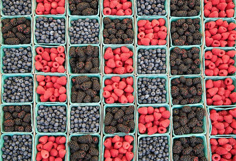 Blueberries, boysenberries and raspberries at a farmers market. Los Angeles, California