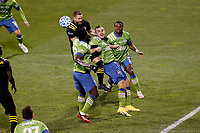 COLUMBUS, OH - DECEMBER 12: Jordan Morris #13 of Seattle Sounders FC battles for the ball against Josh Williams #3 of Columbus Crew during a game between Seattle Sounders FC and Columbus Crew at MAPFRE Stadium on December 12, 2020 in Columbus, Ohio.