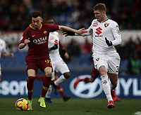 Football, Serie A: AS Roma - Torino, Olympic stadium, Rome, January 19, 2019. <br /> Roma's Stephan El Shaarawy (l) in action with Torino's Lyanco Silveira Neves (r) during the Italian Serie A football match between AS Roma and Torino at Olympic stadium in Rome, on January 19, 2019.<br /> UPDATE IMAGES PRESS/Isabella Bonotto