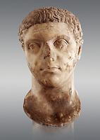 Roman sculpture of the Emperor Caracalla, excavated from Thuburbo-Majus, sculpted circa 211-217AD. The Bardo National Museum, Tunis, Inv No: C. 1347.   Against a grey background.