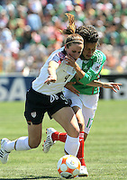 Heather O'Reilly battles for the possession during the USA's 3-1 win vs Mexico in Group A of the 2008 CONCACAF Olympic Women's Qualifying Tournament  in Ciudad Juarez, Mexico, April 6, 2008.