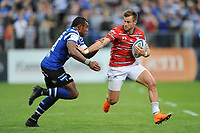 Henry Trinder of Gloucester Rugby hands off Semesa Rokoduguni of Bath Rugby during the Gallagher Premiership Rugby match between Bath Rugby and Gloucester Rugby at The Recreation Ground on Saturday 8th September 2018 (Photo by Rob Munro/Stewart Communications)