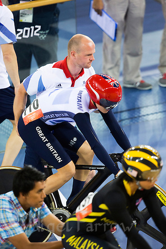 03 AUG 2012 - LONDON, GBR - Victoria Pendleton (GBR) of Great Britain is pushed by coach Jan van Eijden to the start line of her first round race of the Women's Keirin during the London 2012 Olympic Games track cycling in the Olympic Park Velodrome in Stratford, London, Great Britain (PHOTO (C) 2012 NIGEL FARROW)