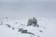 Greenleaf Trail near the summit of Mount Lafayette in extreme weather conditions in the White Mountains, New Hampshire during the winter months. Strong winds cause the snow to blow sideways.