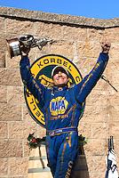 Jul. 31, 2011; Sonoma, CA, USA; NHRA funny car driver Ron Capps celebrates after winning the Fram Autolite Nationals at Infineon Raceway. Mandatory Credit: Mark J. Rebilas-