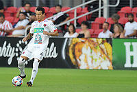 WASHINGTON, DC - JULY 7: Daniel Arreola #4 of Liga Deportiva Alajuense moves the ball during a game between Liga Deportiva Alajuense  and D.C. United at Audi Field on July 7, 2021 in Washington, DC.
