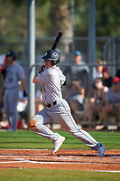 Northeastern Huskies designated hitter Cam Walsh (6) bats during a game against the South Dakota State Jackrabbits on February 23, 2019 at North Charlotte Regional Park in Port Charlotte, Florida.  Northeastern defeated South Dakota State 12-9.  (Mike Janes/Four Seam Images)