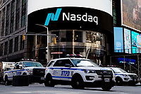 NEW YORK, NEW YORK - MARCH 10: NYPD cars stand guard in front Nasdaq at Times Square on March 10, 2021, in New York. The Nasdaq Composite continued falling more than half a percent during the day also the move away from Apple Inc, Amazon.com Inc , Facebook Inc, Tesla Inc and Microsoft Corp, falling during the day, helped small-cap stocks rise more than double the gains of the S&P 500. (Photo by John Smith/VIEWpress)