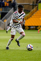23rd May 2021; Molineux Stadium, Wolverhampton, West Midlands, England; English Premier League Football, Wolverhampton Wanderers versus Manchester United; Amad Diallo of Manchester United brings the ball into midfield