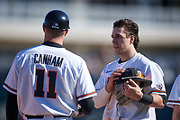 Oregon State Beavers Ryan Ober (18) talks to manager Mitch Canham (11) between innings of an NCAA game against the New Mexico Lobos at Surprise Stadium on February 14, 2020 in Surprise, Arizona. (Zachary Lucy / Four Seam Images)