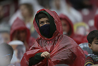 An Arkansas fan covers himself with a poncho as rain starts, Saturday, November 21, 2020 during a football game at Donald W. Reynolds Razorback Stadium in Fayetteville. Check out nwaonline.com/201122Daily/ for today's photo gallery. <br />(NWA Democrat-Gazette/Charlie Kaijo)