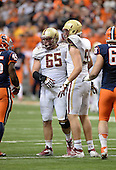 Boston College Eagles defensive lineman Brian Mihalik (99) and Jaryd Rudolph (65) celebrate the sack of quarterback Terrel Hunt (not pictured) during a game against the Syracuse Orange at the Carrier Dome on November 30, 2013 in Syracuse, New York.  Syracuse defeated Boston College 34-31.  (Copyright Mike Janes Photography)