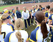 Michigan Wolverines head coach Carol Hutchins talks to her team before the season opener against the Florida Gators on February 8, 2014 at the USF Softball Stadium in Tampa, Florida.  Florida defeated Michigan 9-4 in extra innings.  (Copyright Mike Janes Photography)