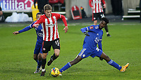 Marcus Forss of Brentford takes the ball past Leicester City's Wilfred Ndidi during Brentford vs Leicester City, Emirates FA Cup Football at the Brentford Community Stadium on 24th January 2021
