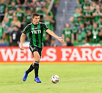 AUSTIN, TX - JUNE 19: Matt Besler #5 of Austin FC brings the ball up the field while getting his teammates ready for a pass during a game between San Jose Earthquakes and Austin FC at Q2 Stadium on June 19, 2021 in Austin, Texas.