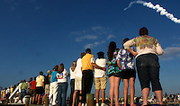 Spectators watch from a Titusville, FL dock as Space Shuttle DIscovery rises from Kennedy Space Center for the final time, February 24, 2011.  (Photo by Brian Cleary/www.bcpix.com)