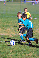 mixed ethnic boys soccer game action
