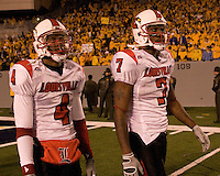 Louisville wide receivers Patrick Carter (4) and Mario Urrutia walk dejectedly off the field after the West Virginia Mountaineers defeated the Louisville Cardinals 38-31 on November 08, 2007 at Mountaineer Field, Morgantown, West Virginia. .