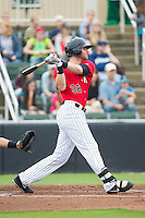 Danny Hayes (32) of the Kannapolis Intimidators follows through on his swing against the West Virginia Power at CMC-Northeast Stadium on April 30, 2014 in Kannapolis, North Carolina.  The Intimidators defeated the Power 2-1 in game one of a double-header.  (Brian Westerholt/Four Seam Images)
