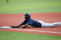 RJ Johnson (1) of Kerr Vance Academy (NC) playing for the Atlanta Braves scout team slides head first into third base during game four of the South Atlantic Border Battle at Truist Point on September 27, 2020 in High Pont, NC. (Brian Westerholt/Four Seam Images)
