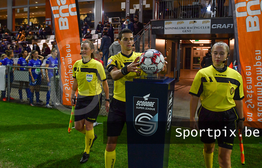 referees with Joline Delcroix , Bert Verbeke and Shauni Depruyst pictured entering the pitch during a female soccer game between  AA Gent Ladies and Sporting Charleroi Feminin on the fifth matchday of the 2020 - 2021 season of Belgian Scooore Womens Super League , friday 16 th of October 2020  in Oostakker , Belgium . PHOTO SPORTPIX.BE | SPP | DAVID CATRY