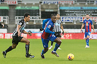 2nd February 2021; St James Park, Newcastle, Tyne and Wear, England; English Premier League Football, Newcastle United versus Crystal Palace; Michy Batshuayi of Crystal Palace shields the ball from Isaac Hayden of Newcastle United