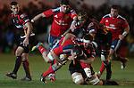 Dragons flanker Nic Cudd hauls down Munster number 8 James Coughlan.<br /> RaboDirect Pro12<br /> Newport Gwent Dragons v Munster<br /> Rodney Parade - Newport<br /> 29.11.13<br /> ©Steve Pope-SPORTINGWALES