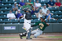Winston-Salem Dash catcher Omar Narvaez (22) reaches for a high throw as Ivan Castillo (12) of the Lynchburg Hillcats slides into home at BB&T Ballpark on May 29, 2015 in Winston-Salem, North Carolina.  The Dash defeated the Hillcats 8-1.  (Brian Westerholt/Four Seam Images)