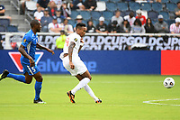KANSASCITY, KS - JULY 11: Mark-Anthony Kaye #14 of Canada passes the ball during a game between Canada and Martinique at Children's Mercy Park on July 11, 2021 in KansasCity, Kansas.