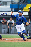 Burlington Royals catcher Meibrys Viloria (4) tosses his mask as he chases after a wild pitch during the game against the Danville Braves at Burlington Athletic Park on July 12, 2015 in Burlington, North Carolina.  The Royals defeated the Braves 9-3. (Brian Westerholt/Four Seam Images)