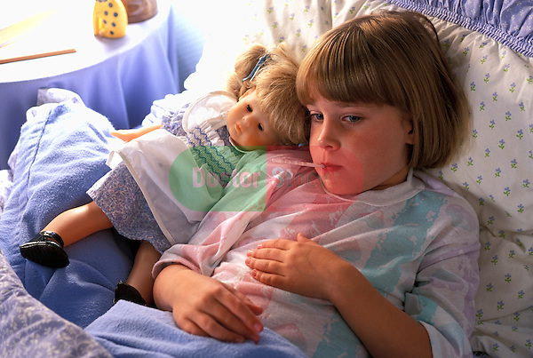 sad looking sick young girl in bed with doll and oral thermometer in mouth