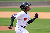 Wisconsin Timber Rattlers shortstop Devin Hairston (1) races to first base during a Midwest League game against the Lansing Lugnuts on May 8, 2018 at Fox Cities Stadium in Appleton, Wisconsin. Lansing defeated Wisconsin 11-4. (Brad Krause/Four Seam Images)