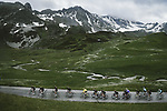 The peloton with Yellow Jersey Tadej Pogacar (SLO) UAE Team Emirates on Cormet de Roselend during Stage 9 of the 2021 Tour de France, running 150.8km from Cluses to Tignes, France. 4th July 2021.  <br /> Picture: A.S.O./Pauline Ballet   Cyclefile<br /> <br /> All photos usage must carry mandatory copyright credit (© Cyclefile   A.S.O./Pauline Ballet)
