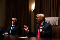 United States President Donald J. Trump speaks during a meeting with members of the National Association of Police Organizations Leadership in the Cabinet Room of the White House in Washington, DC, on July 31st, 2020. United States Vice President Mike Pence looks on from left.<br /> Credit: Anna Moneymaker / Pool via CNP /MediaPunch