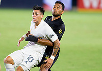 CARSON, CA - SEPTEMBER 06: Cristian Pavon #10 of the Los Angeles Galaxy is held by Eddie Segura #4 of LAFC during a game between Los Angeles FC and Los Angeles Galaxy at Dignity Health Sports Park on September 06, 2020 in Carson, California.