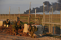 Israeli infantry soldiers enter Gaza through a gate on the border. Israeli forces began an air offensive against Hamas in Gaza on 27/12/2008, which quickly escalated into an offensive by land, sea and air, in retaliation against Palestinian rockets fired into Israel. After eight days of bombardment, leaving over 400 Palestinians and four Israelis dead, Israeli tanks entered Gaza on 04/01/2009...