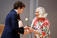 USA International Harp Competition Founder and Artistic Director Susann McDonald, right, gives a rose to contestant Marcel Cara of France during the opening ceremony of the 11th USA International Harp Competition at Indiana University in Bloomington, Indiana on Wednesday, July 3, 2019. (Photo by James Brosher)