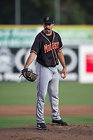 Modesto Nuts starting pitcher Danny Garcia (14) prepares to deliver a pitch during a California League game against the San Jose Giants at San Jose Municipal Stadium on May 15, 2018 in San Jose, California. Modesto defeated San Jose 7-5. (Zachary Lucy/Four Seam Images)