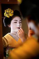 Geisha Applying Lipstick in Kyoto, Japan