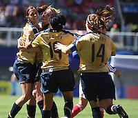 Chile, Chillan::Usa's Alex Morgan soccer players celebrate a goal against France's team during the match of the Fifa U-20 Women's World Cup at the Nelson Oyarz˙n stadium in Chill·n, on November the ninth 2008 2008.  GROSNIA / sergio Araneda