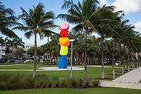 Miami, Florida.  Collins Park, South Beach. Sculpture is Miami Mountain by Ugo Rondinone.