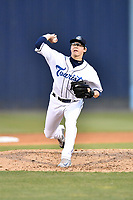 Asheville Tourists starting pitcher Garrett Schilling (18) delivers a pitch during a game against the Columbia Fireflies at McCormick Field on April 13, 2018 in Asheville, North Carolina. The Tourists defeated the Fireflies 5-1. (Tony Farlow/Four Seam Images)