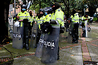 BOGOTA, COLOMBIA - MAY 05 : Police officers stand guard during the National strike on May 5, 2021 in the outskirts of Bogota, Colombia. Ahead of further planned protest in the country, Amnesty International has published evidence of excessive use of force being used against protesters by the security forces United Nations, European Union and rights bodies joined at criticism, official data show  19 people were killed and 846 injured during  clashes with the security forces. (Photo by Leonardo Munoz/VIEWpress)